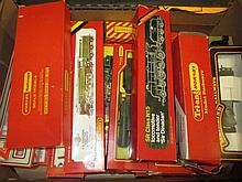 Four boxes containing a large collection of Hornby 00 and HO gauge model railways