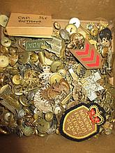 Collection of military cap badges and buttons