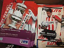 Two boxes containing a large quantity of various mixed football programmes including 1980's and '90's etc