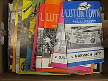Two boxes containing a large quantity of mixed 1970's and '80's football programmes of various teams