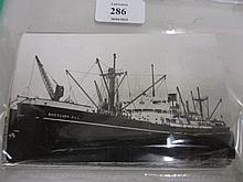 Similar folio containing a quantity of 1940's photographs of shipping