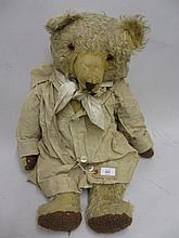 Large straw stuffed jointed teddy bear