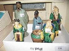 Group of three Chinese glazed pottery figures of gentlemen and two later glazed pottery figures of oriental men
