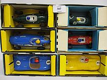 Three boxes containing a collection of later Scalextric models and accessories
