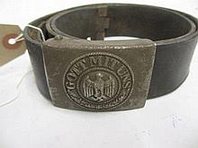 Third Reich leather belt with metal buckle embossed ' Gott Mituns ', with oak leaves surrounding an eagle with outstretched wings above a swastika