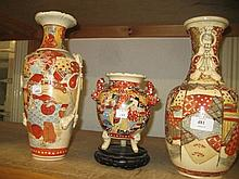 Pair of Satsuma baluster form vases and a similar smaller vase
