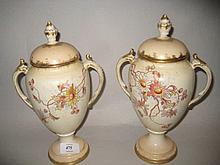 Pair of Royal Bonn floral decorated blush ivory two handled vases with covers