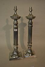 Pair of silver plated table lamp bases with fluted columns and square bases