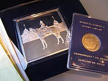 9ct Gold Queen Elizabeth II commemorative coin in case together with a similar silver medallion
