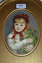 Small oval mounted painting on glass of a girl wearing a red bonnet and carrying holly and ivy, inscribed verso, painted by Emily Mary Baker, 7ins x 5ins, gilt framed