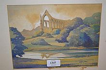 J. Lewis Stant, watercolour of a ruined abbey in a landscape together with another watercolour, signed A.M. Sheridan of a park with church and buildings