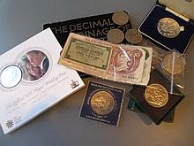 Silver coin in box together with a quantity of loose bank notes and other World coinage