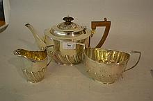 Silver three piece tea service of oval half fluted design, London 1901