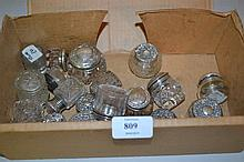 Box containing a large quantity of silver lidded cut glass dressing table bottles and jars etc