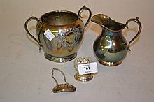 George III silver whisky decanter label, silver backed hand mirror, plated jug and sugar basin and a cut glass silver mounted salt