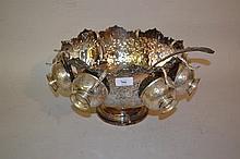 Large circular silver plated pedestal punch bowl with eight cups and ladle