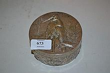 Continental silver circular box with hinged cover decorated in relief with a child and stork