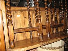 19th Century stripped and polished pine church pew with boarded back and plank seat on slab end supports