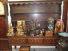 18th Century oak dresser with boarded shelf back above three drawers with brass swan neck handles, raised on cabriole front supports