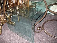 Nest of three modern shaped glass coffee tables