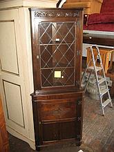 Reproduction oak standing corner cabinet together with a reproduction oak side cabinet