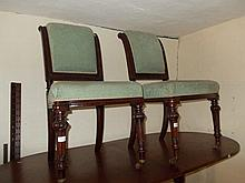 Set of four 19th Century mahogany and upholstered dining chairs on turned fluted supports together with a pair of Continental ebonised side chairs with wool work back and seats