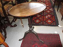 George III circular mahogany pedestal table on tripod support