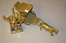 Brass model coach and horse together with a brass companion set