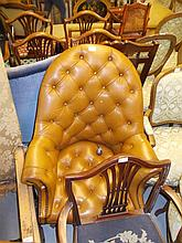 20th Century tan button leather upholstered tub shaped revolving office chair on splay reeded supports with casters (a/f)