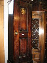 Narrow stained pine cupboard with single door and a small oak gate leg table