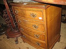 Small reproduction walnut bow front bedside chest of four drawers