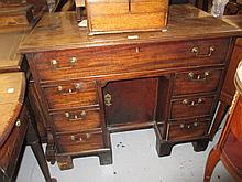 George III mahogany kneehole desk, the moulded top above seven drawers surrounding a central kneehole cupboard raised on bracket feet (patch to top)
