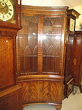 Pair of good quality reproduction mahogany inverted bow front standing corner cabinets