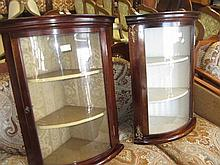 Small reproduction mahogany bow front hanging corner cabinet together with another similar