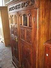 19th / 20th Century Indo Portuguese side cabinet, the moulded cornice above a pair of carved panelled and glazed cupboard doors enclosing a void interior