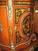 Reproduction French serpentine shaped metal mounted side cabinet with a composition marble top above floral painted drawer and cupboard door
