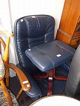 Modern blue leather upholstered swivel chair and matching footstool