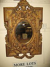 Large reproduction gilt moulded composition wall mirror with urn surmount