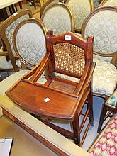 Child's stained beech high chair with cane work seat and back