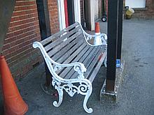 White painted cast aluminium and wooden slatted garden bench