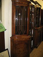 Reproduction burr walnut standing corner cabinet with bar glazed door above a panel door together with a similar dark mahogany corner cabinet