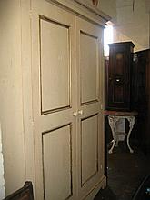 Late 20th Century cream painted wardrobe having moulded cornice above two panelled doors with fitted interior on a shaped plinth base