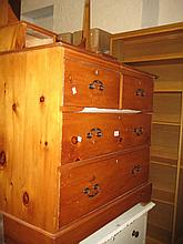 Pine washstand with oval swing mirror above jewel drawers, together with a pine open bookshelf
