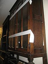 Mid 20th Century oak bookcase with two bar glazed doors on low baluster turned supports