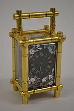 Early 20th Century gilt brass miniature carriage clock, the simulated bamboo four glass case enclosing a floral decorated black enamel dial and single train key wind movement with lever escapement
