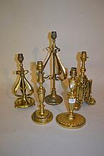 Five various brass table lamps