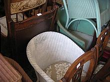 Lloyd Loom type tub chair, similar green chair, set of five reproduction dining chairs and a pine dining chair