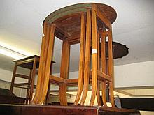 Nest of three oval walnut occasional tables