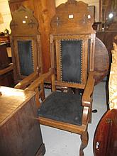 Pair of large early 20th Century oak open elbow chairs with arched and upholstered backs and seats and cabriole front supports
