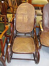 Bentwood rocking chair with caned back and seat